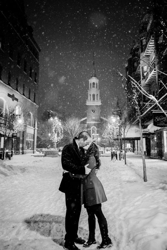 Couple in the snow having engagement photos taken