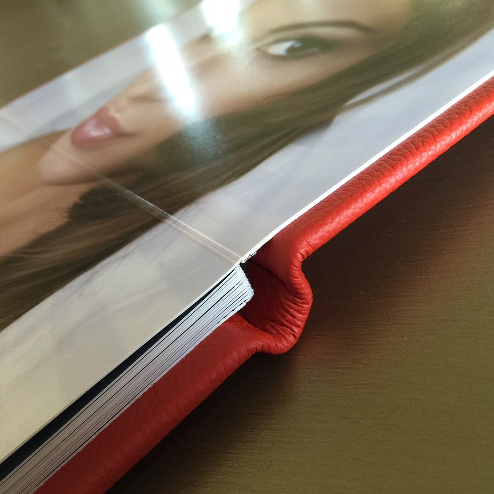 Lay flat boudoir book with red leather cover